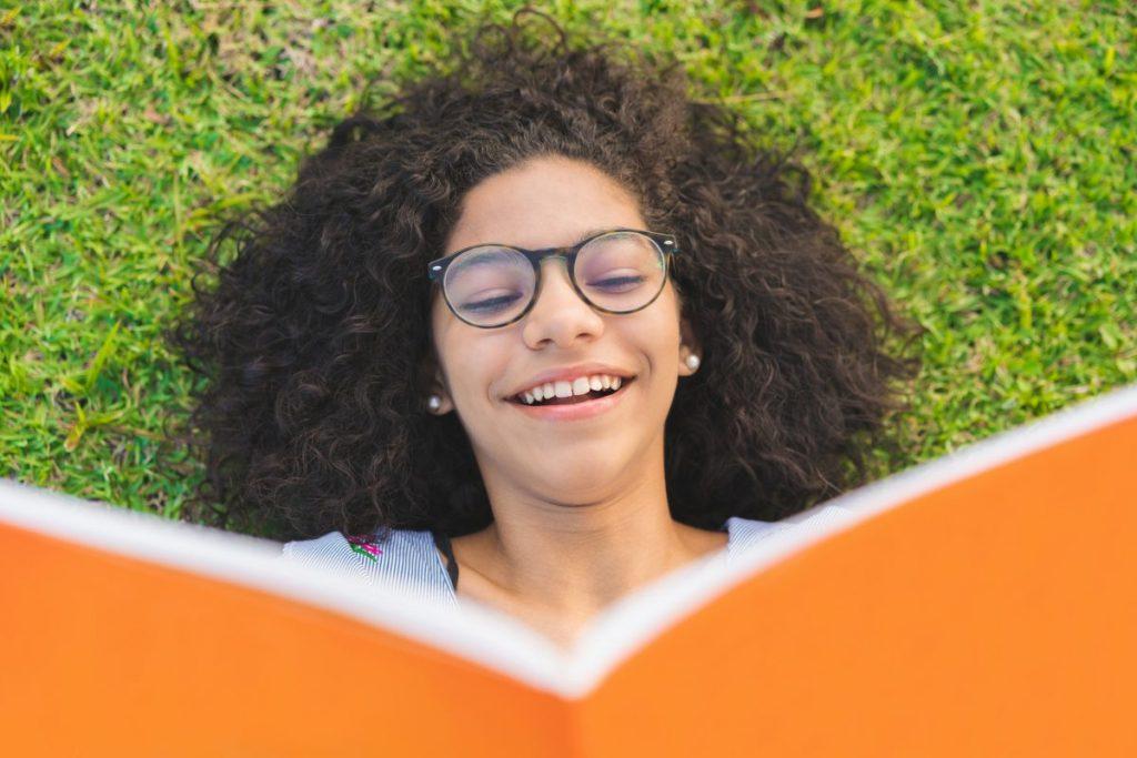 girl reading happy
