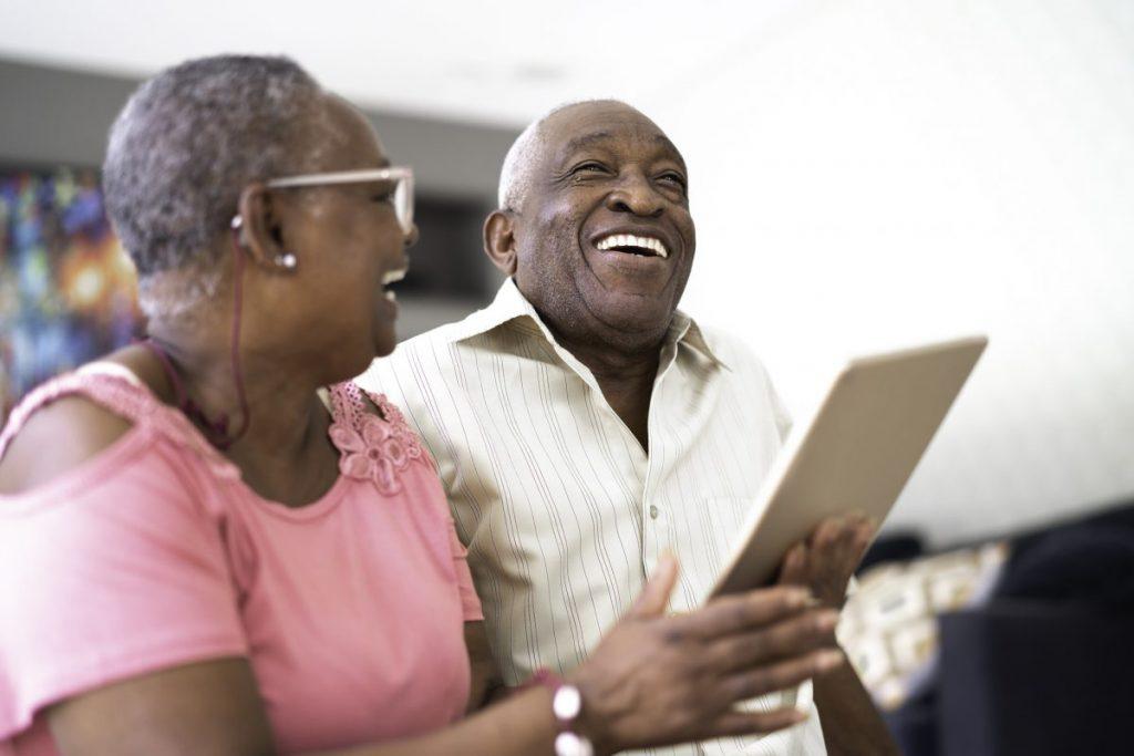 elderly couple using tablet