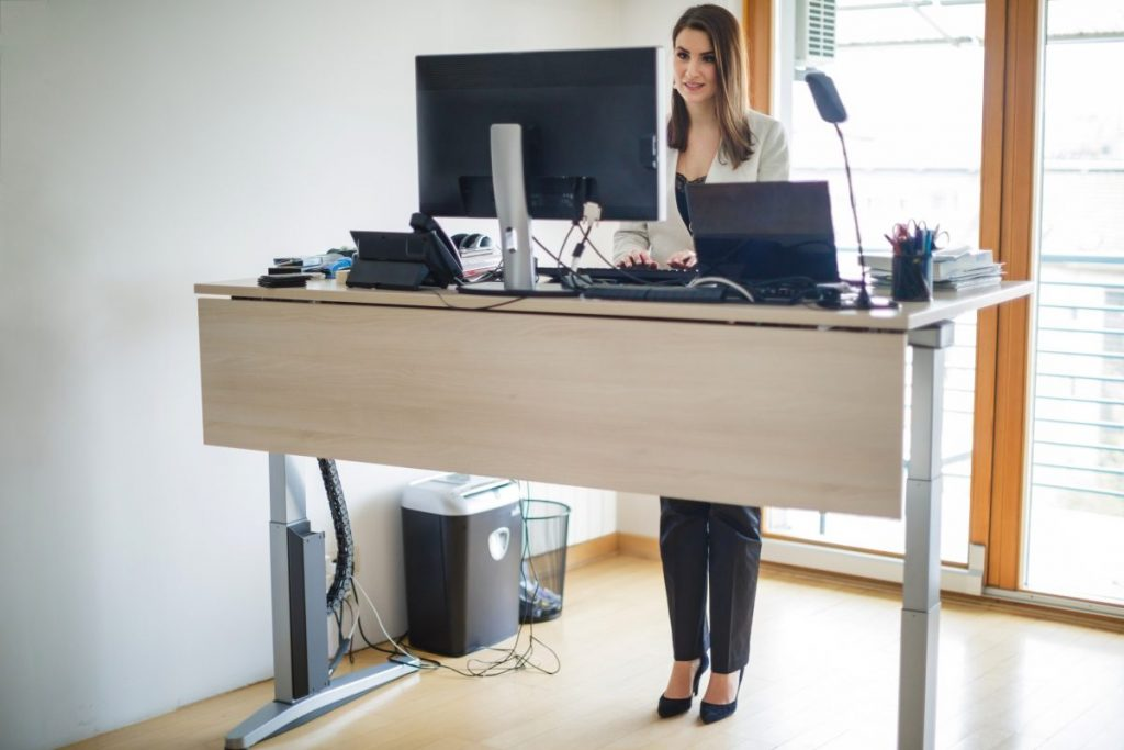 woman standing desk office