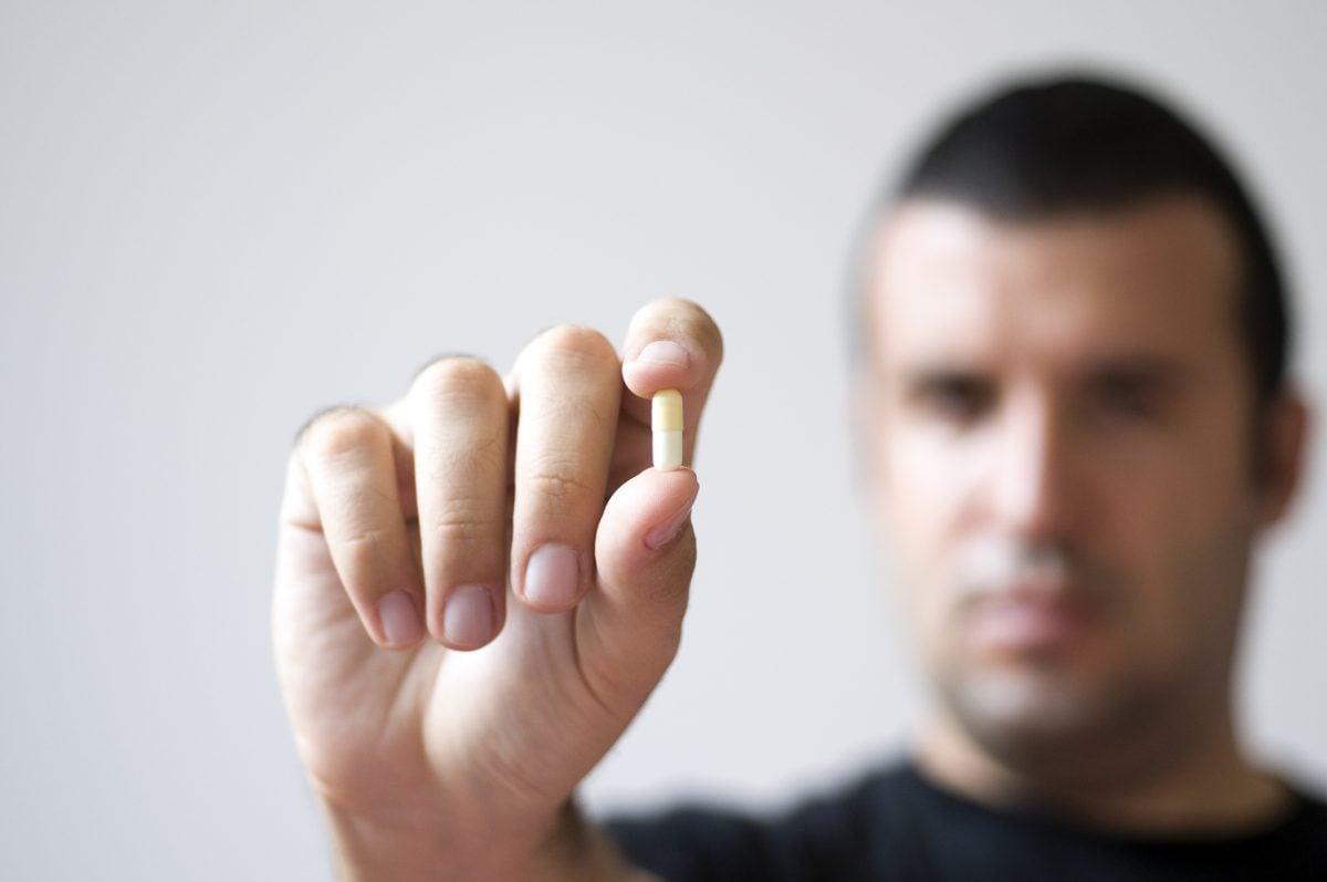 Man holding single tablet