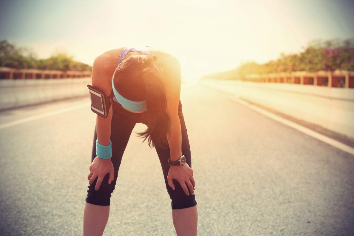woman runner taking break