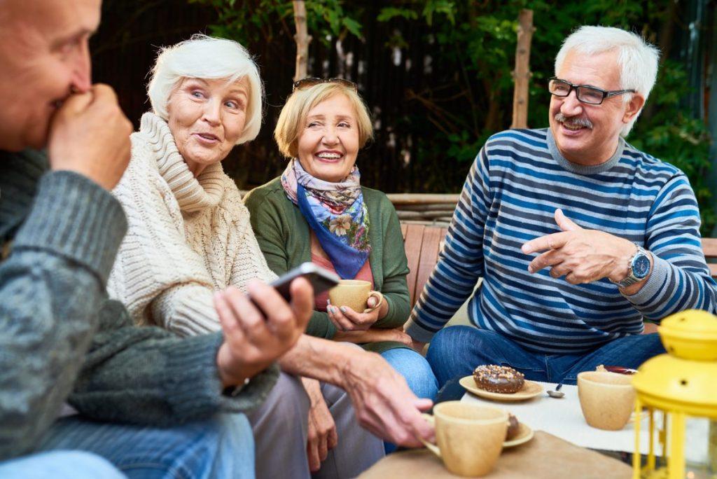 seniors talking conversation outdoors
