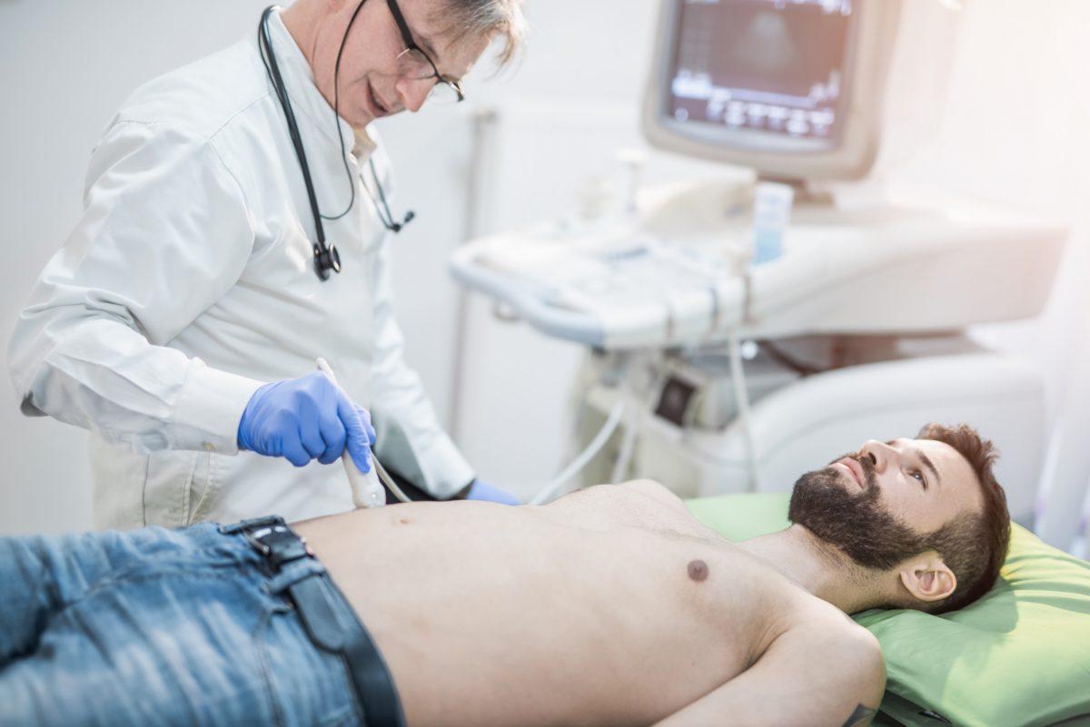 Man undergoing an ultrasound scan