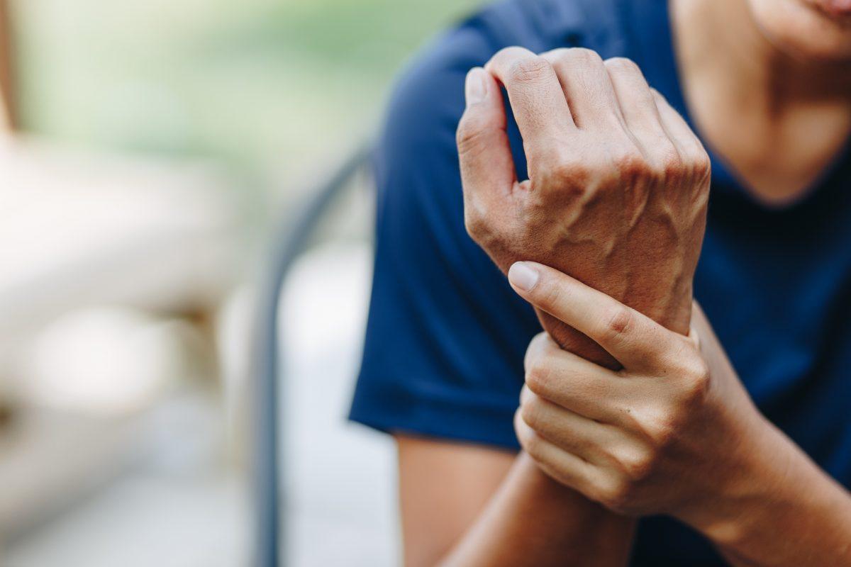 Person rubbing wrist