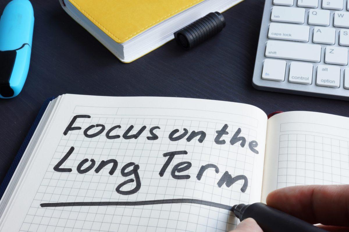 man writing focus long term