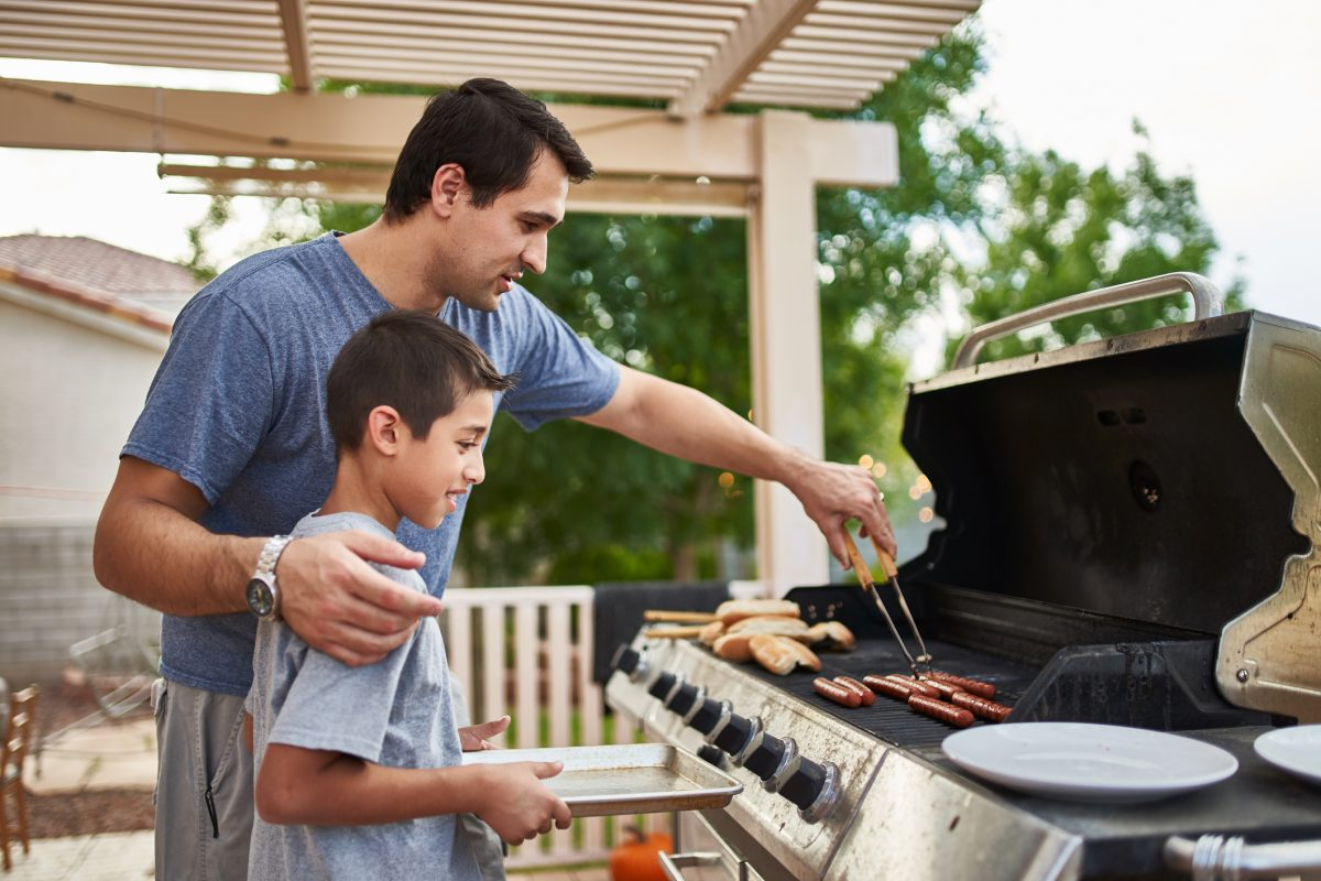 father son grilling