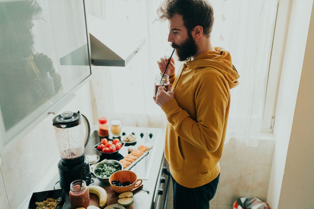 man juicing fruits vegetables