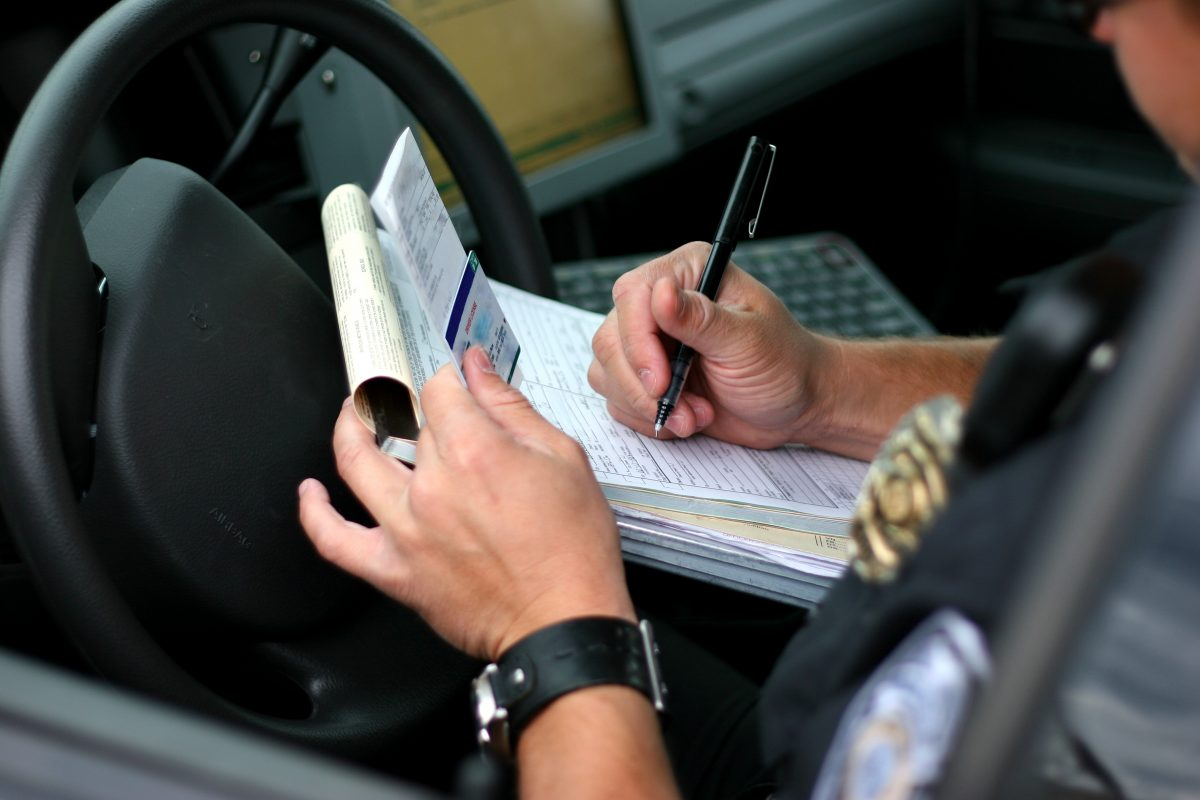 officer writing citation fine