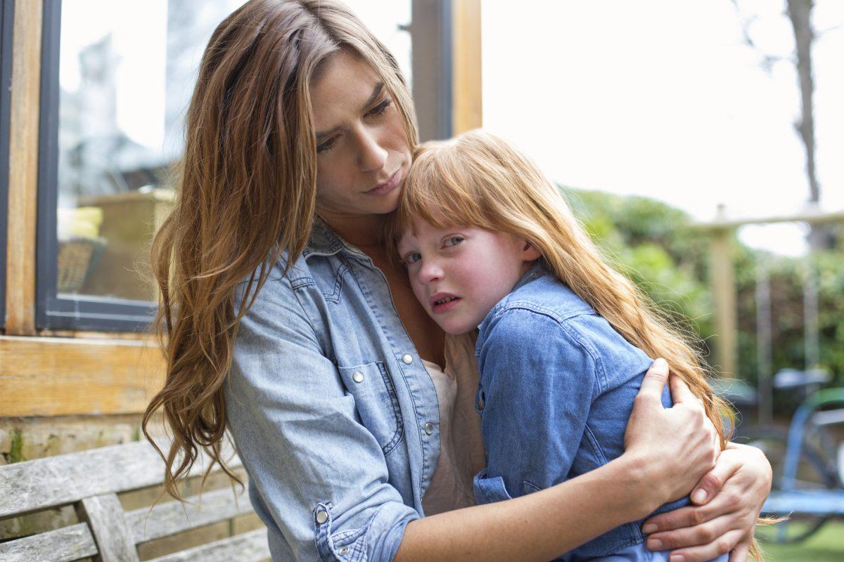 mother hugging upset child