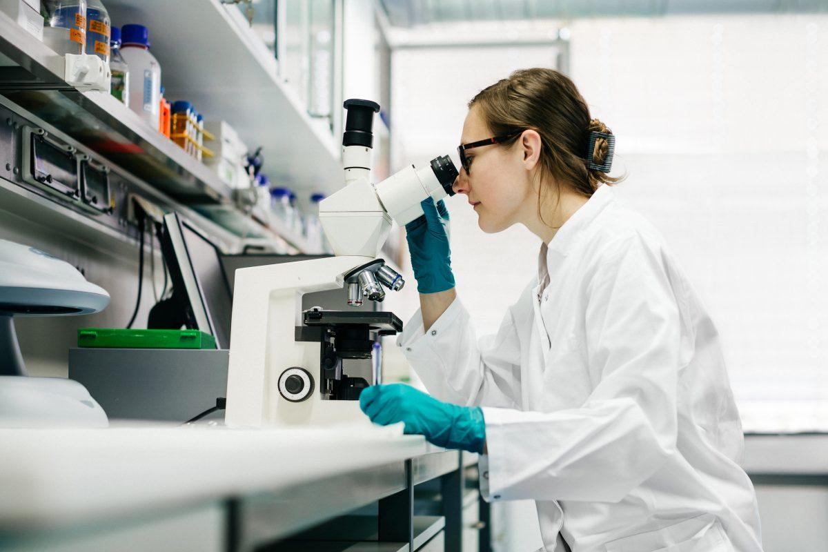 researcher scientists microscope