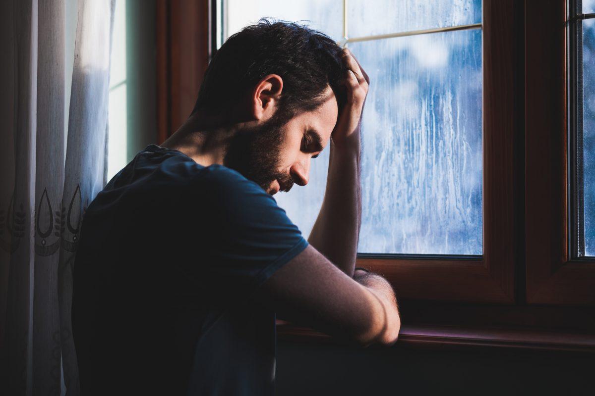 man, sad and alone