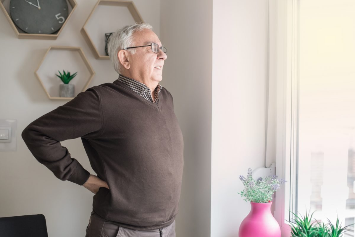 older man bending backward