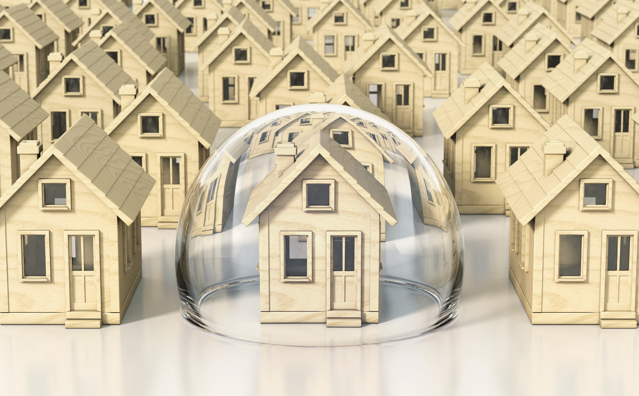 Toy wooden miniature houses, one under glass dome