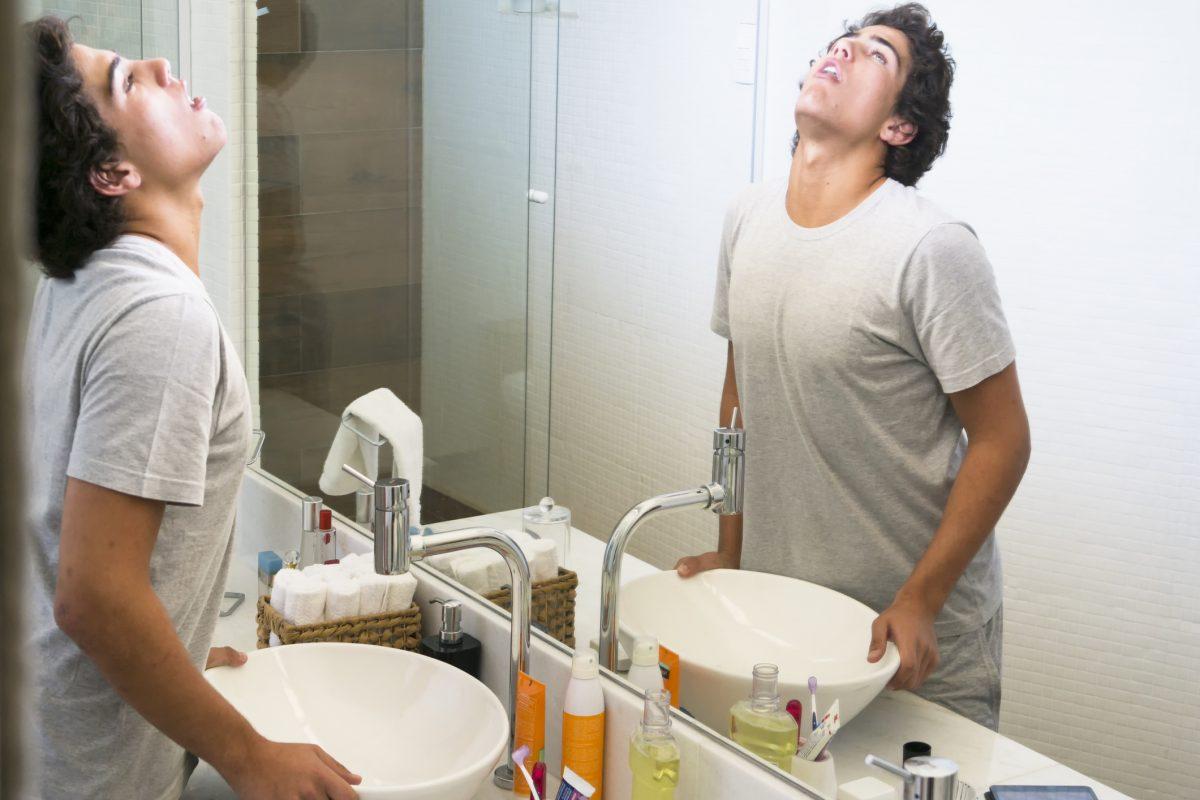 boy gargling mouthwash