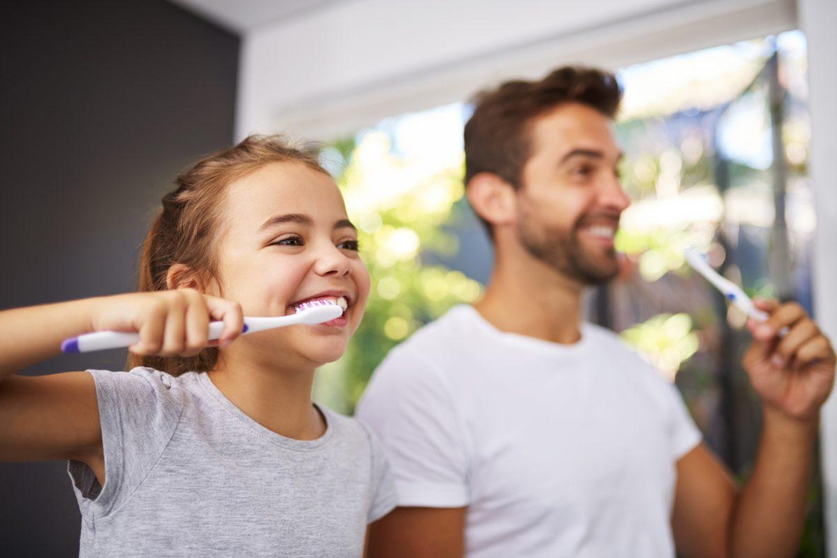 dad daughter brush teeth
