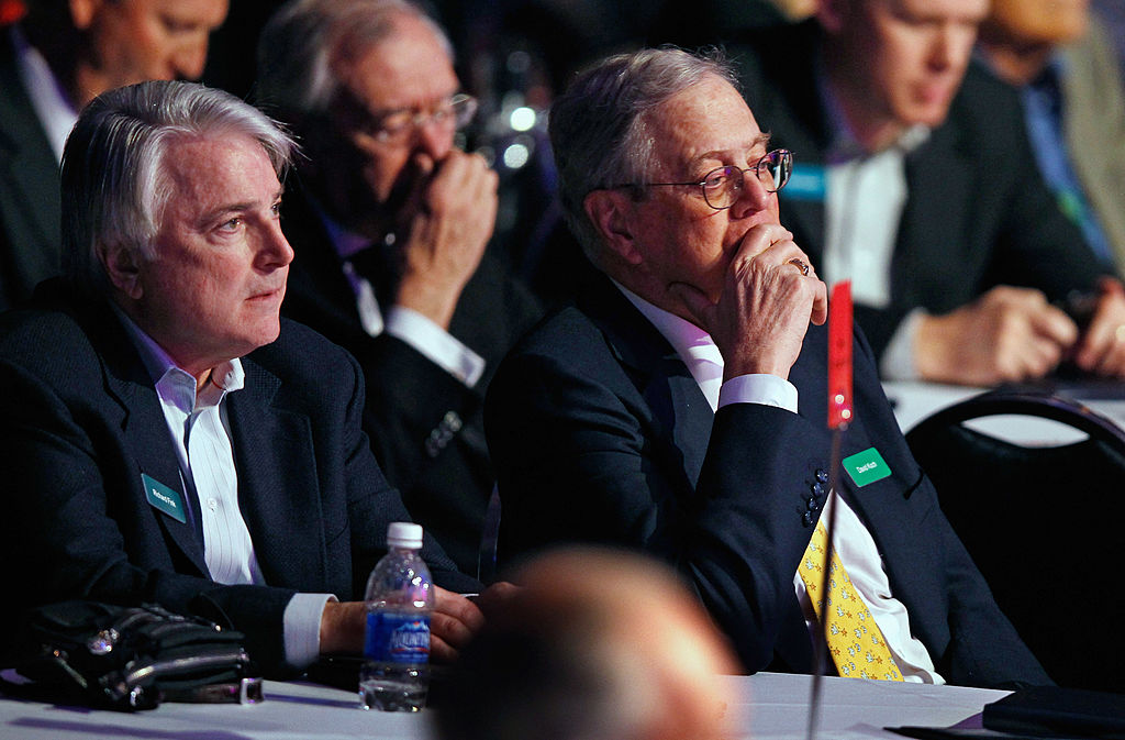WASHINGTON, DC - NOVEMBER 04: Koch Industries Executive Vice President Richard Fink (L) and Americans for Prosperity Foundation chairman and Koch Industries Executive Vice President David H. Koch listens to speakers during the Defending the American Dream Summit at the Washington Convention Center November 4, 2011 in Washington, DC. The conservative political summit is organized by Americans for Prosperity, which was founded with the support of Koch and his brother David H. Koch.