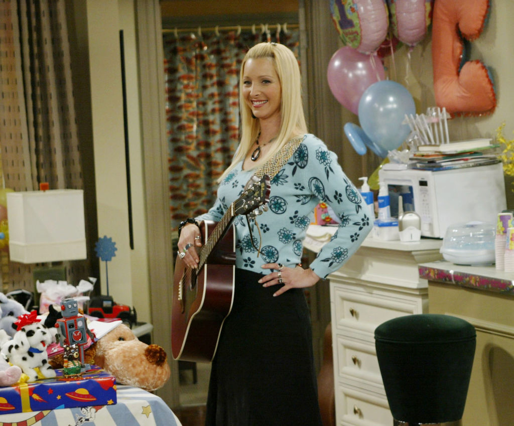 "Lisa Kudrow, who plays the ditzy Phoebe Buffay on the hit NBC series ""Friends"" performs during one of the series' last shows on the Warner Bros lot Sept. 12, 2003 in Burbank, CA. ""Friends,"" which is in its ninth and final season, debuted in 1994, has won 44 Emmys, and is one of the biggest successes in television history."