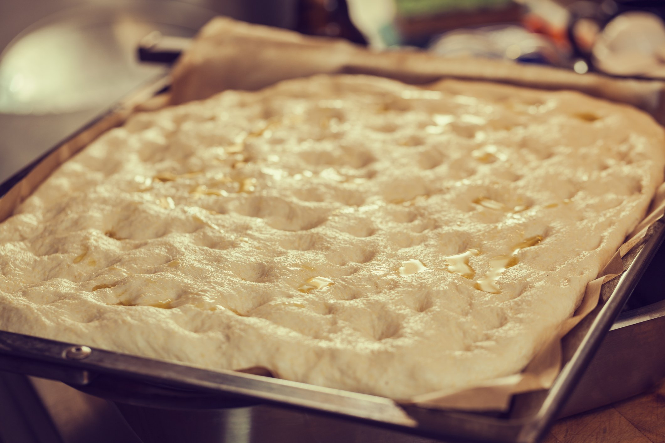 Focaccia bread dough ready for baking;