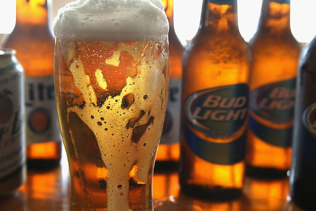 CHICAGO, IL - SEPTEMBER 15: In this photo illustration, bottles of Miller Lite and Bud Light beer that are products of SABMiller and Anheuser-Busch InBev (respectively) are shown on September 15, 2014 in Chicago. Illinois. Shares of SABMiller have surged to an all-time high today on speculation of a takeover bid by Anheuser-Busch InBev, the world's largest brewer.