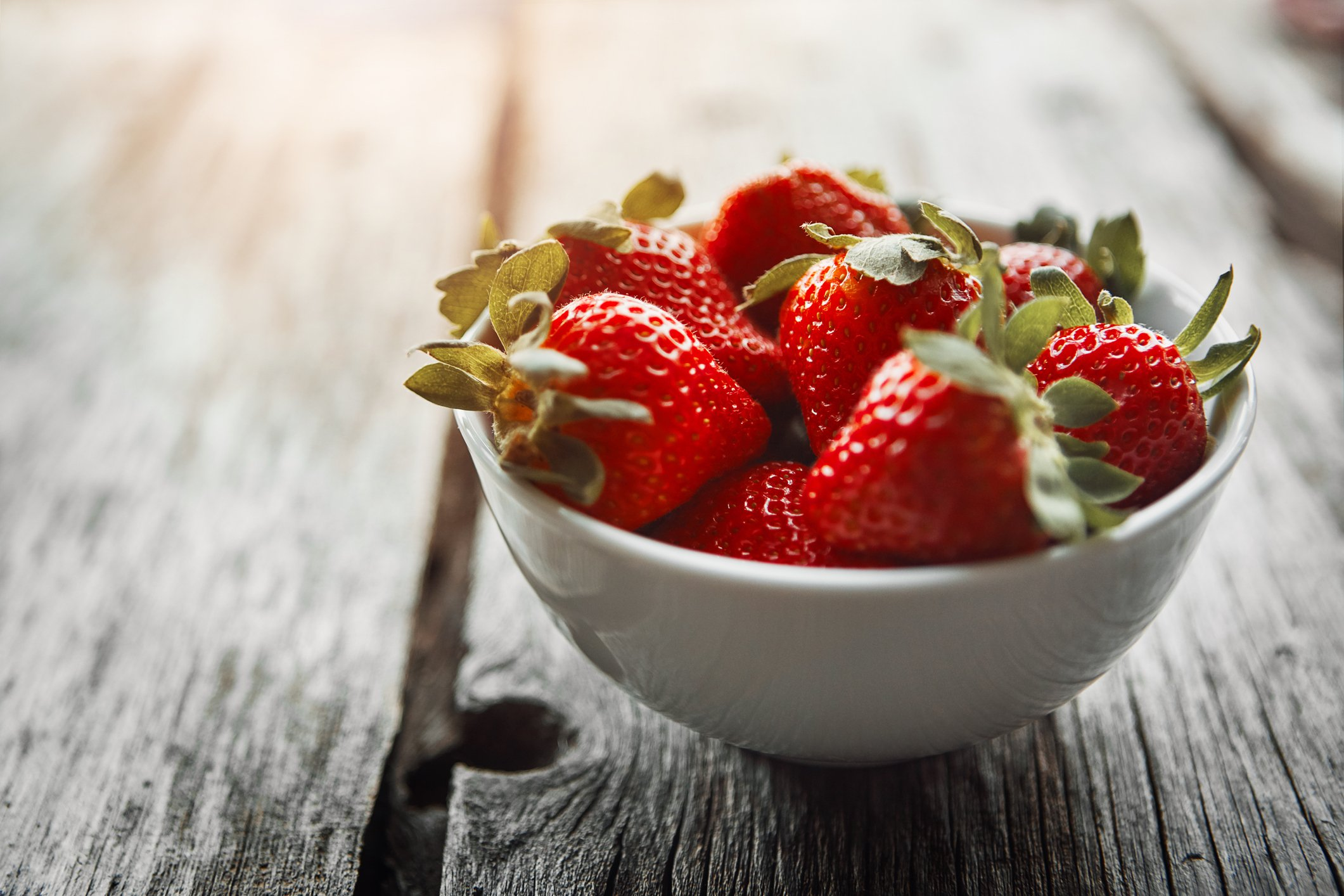 Shot of a bowl of fresh strawberries on a table