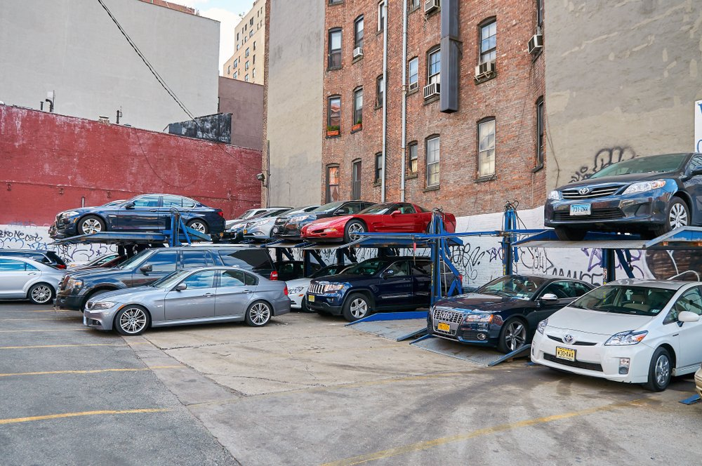 View on NYC special vertical cars parking area double deck metal construction.