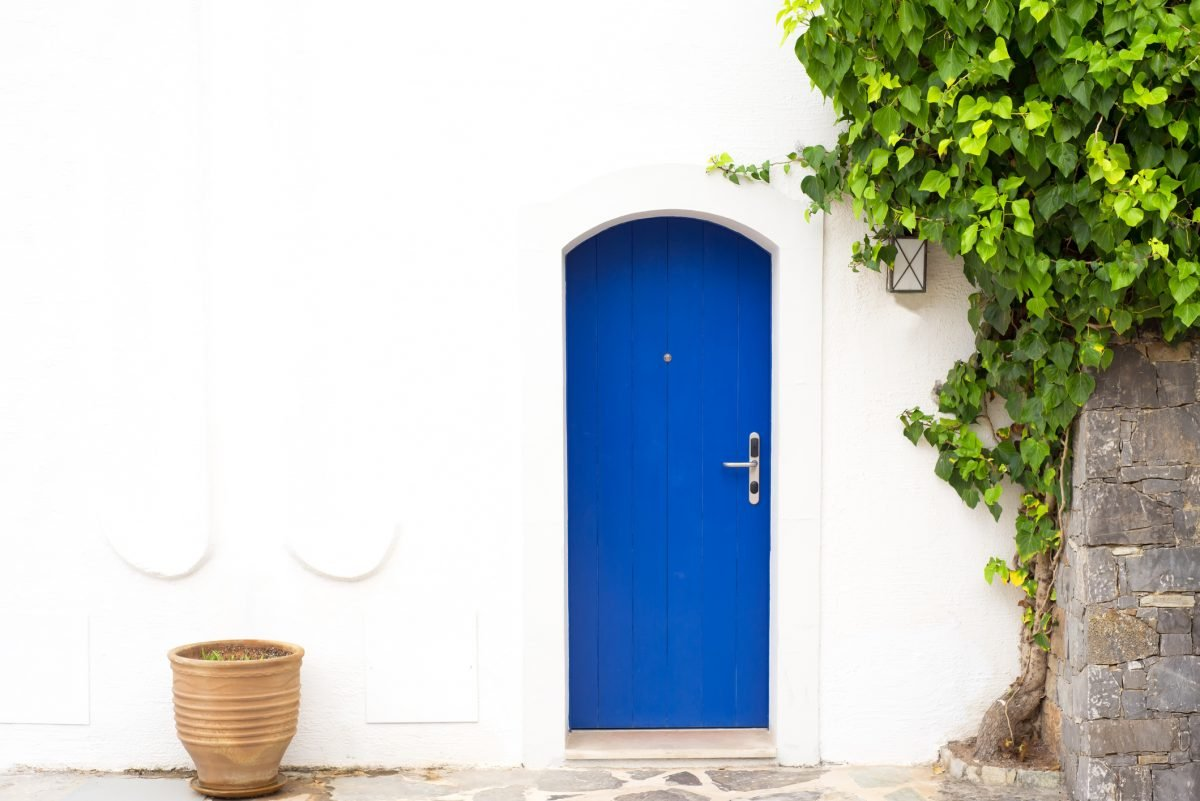 Blue door and whitewashed exterior