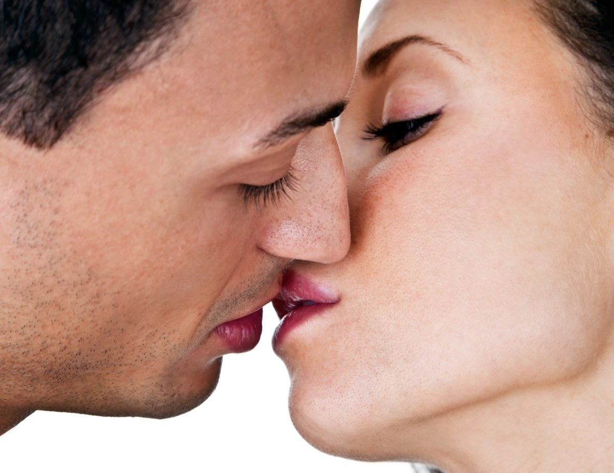 Close up of kissing couple