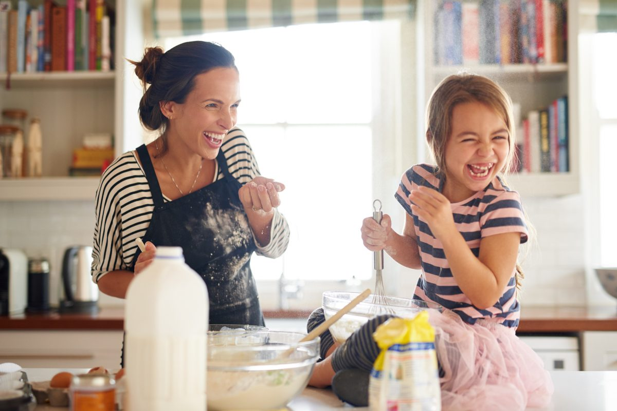 mother daughter kitchen playful baking