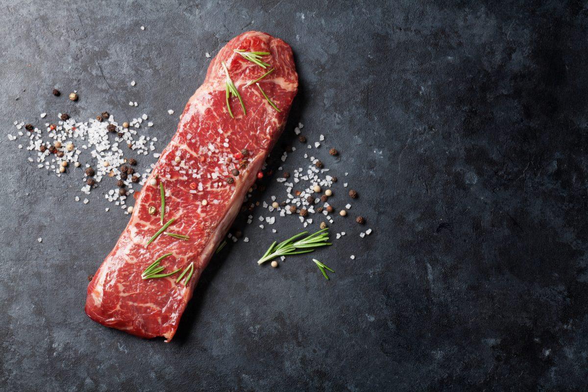 grilling steak with salt seasoning