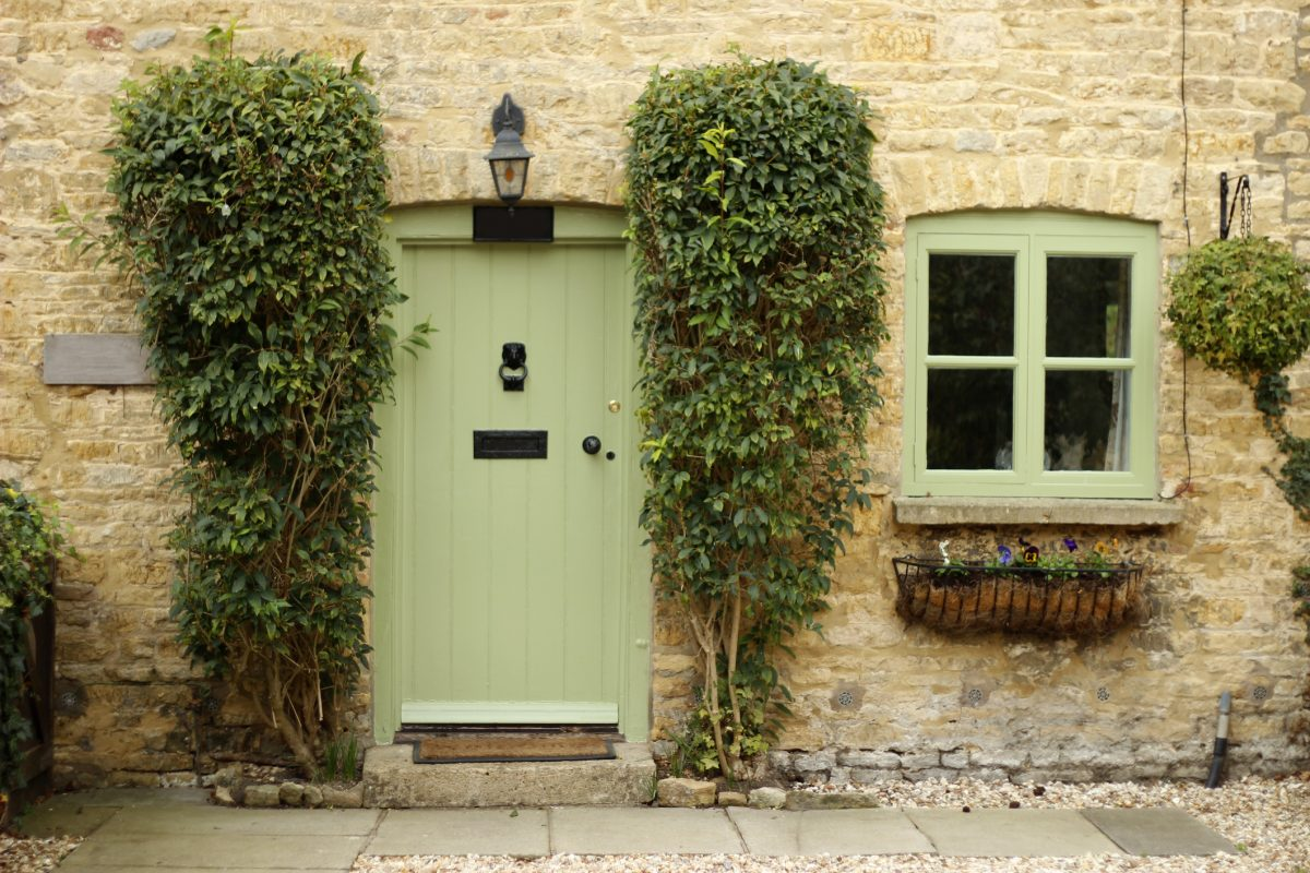 Cottage with pale green door