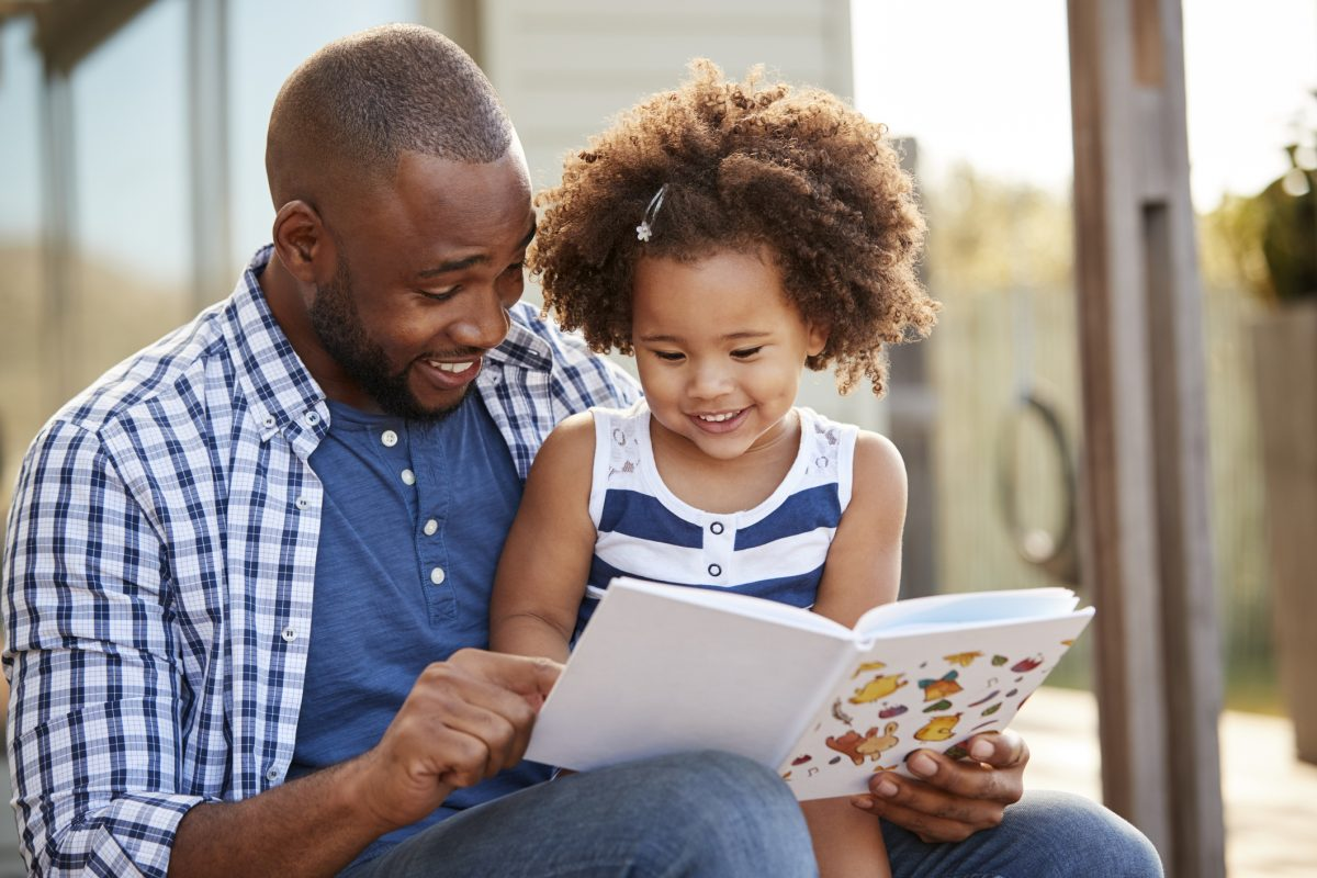 family father daughter reading book