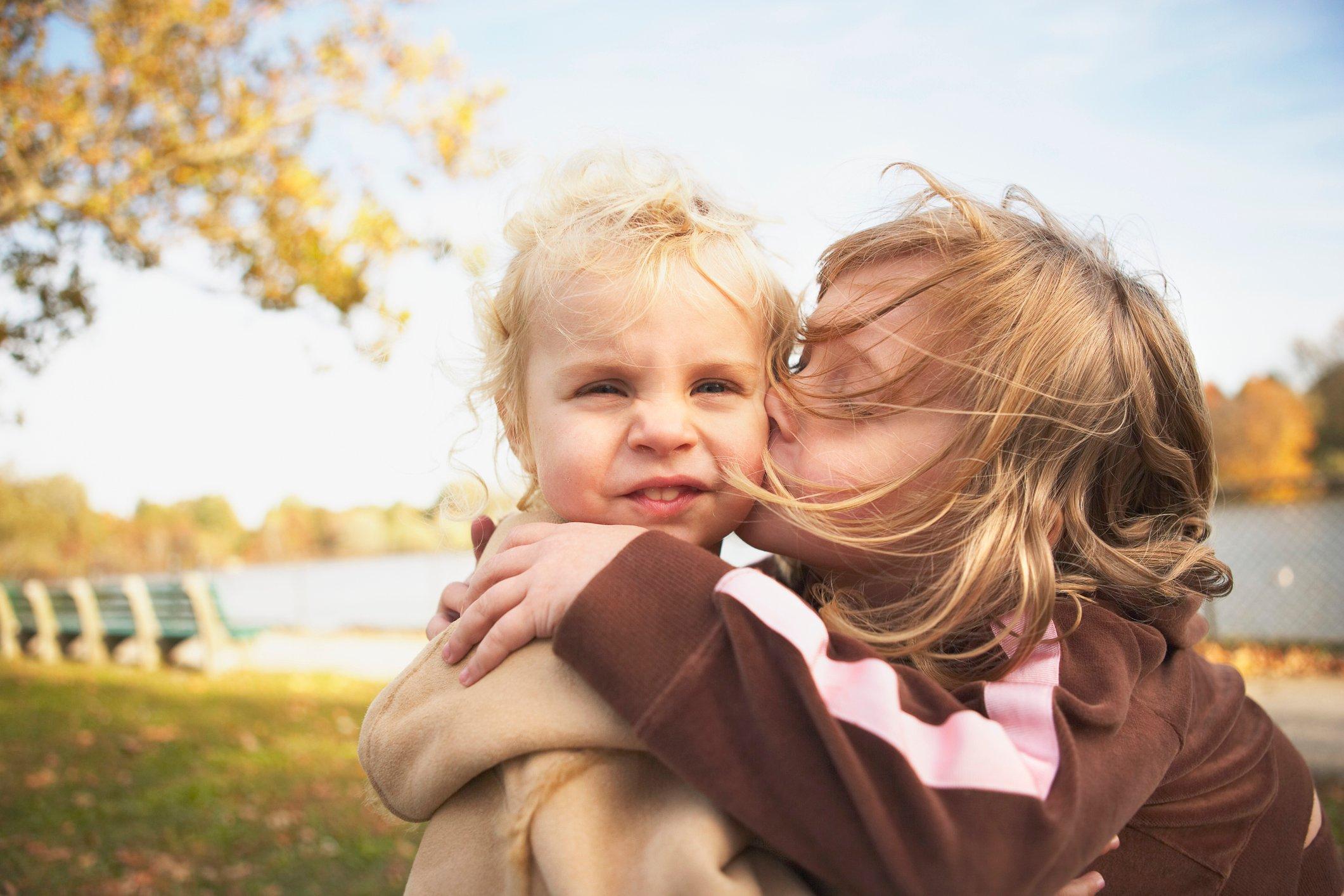 Older Sister Kissing Younger Sister
