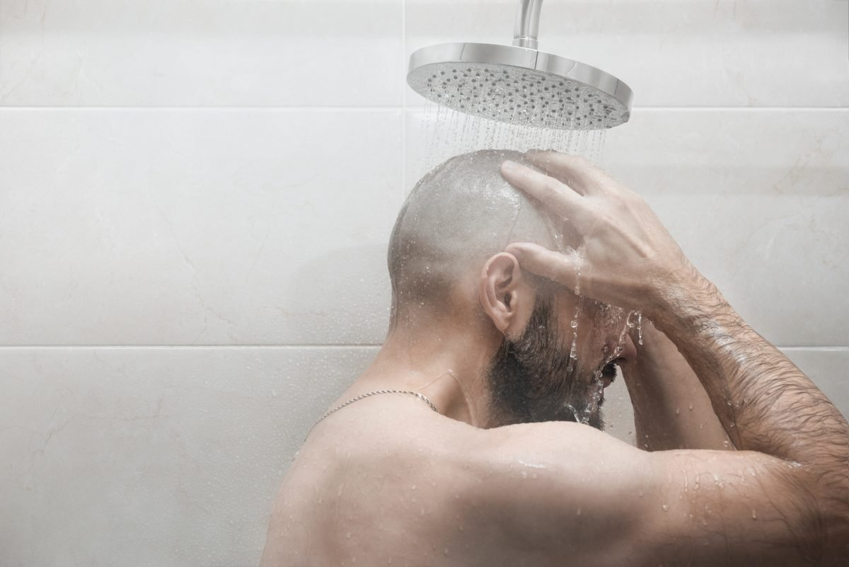 man showering hygiene