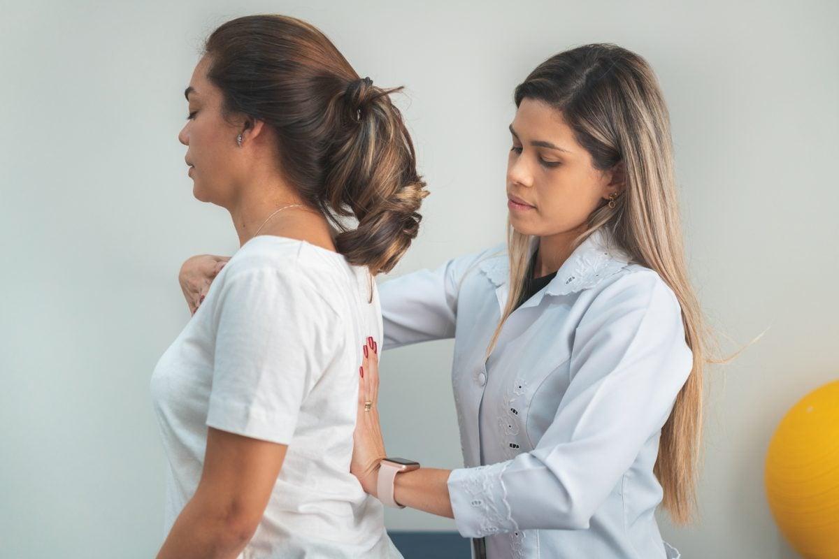 doctor fixing posture