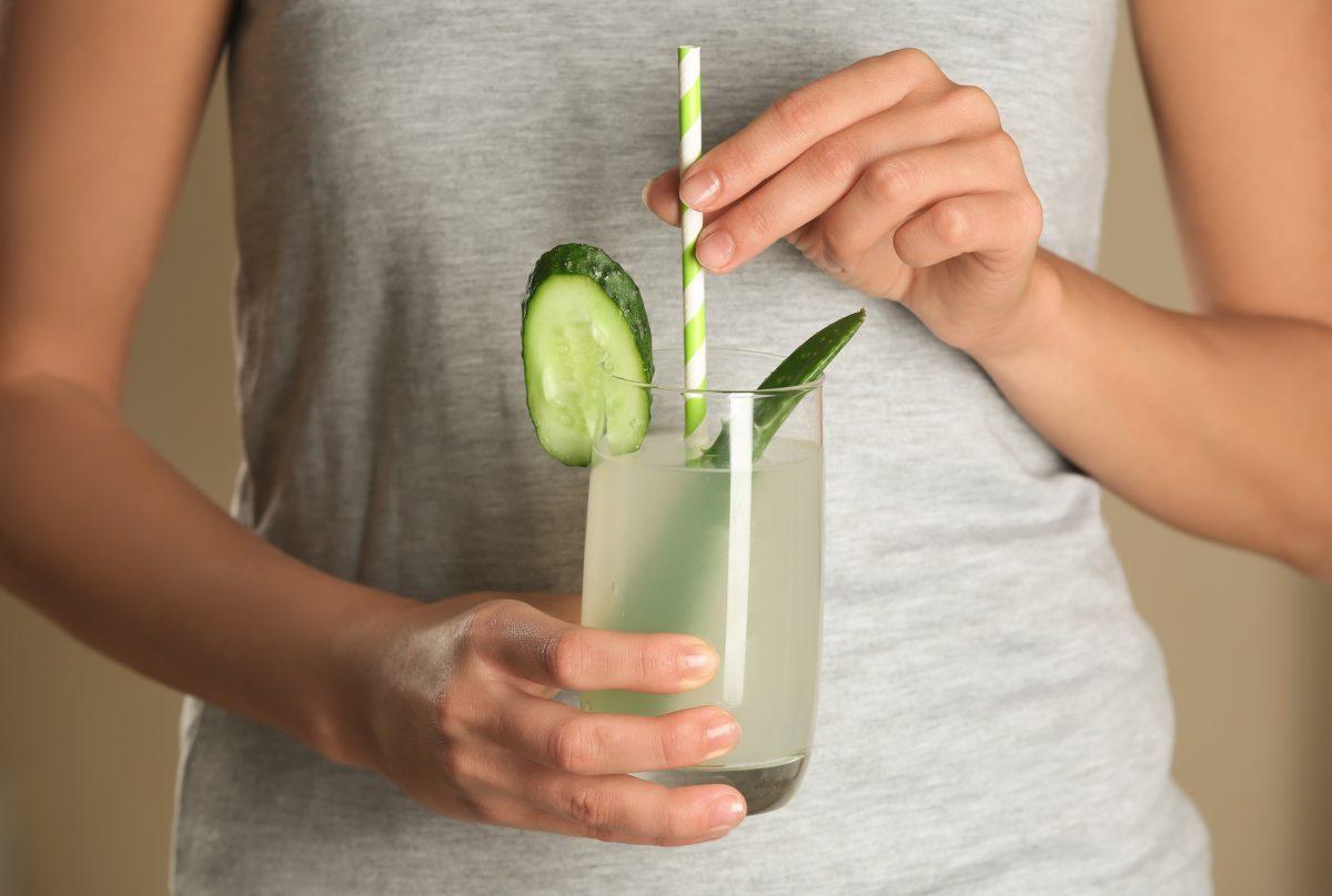 woman drinking aloe vera juice