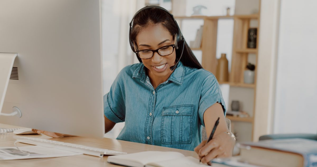 woman using headset home office