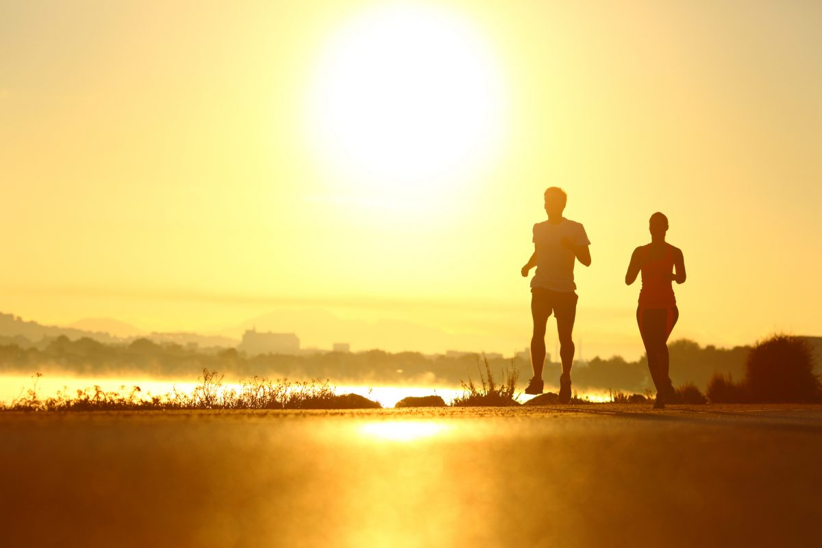 Man and woman running early