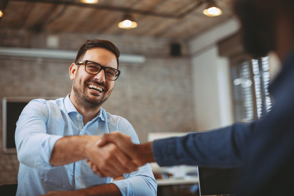 man shaking hands in office