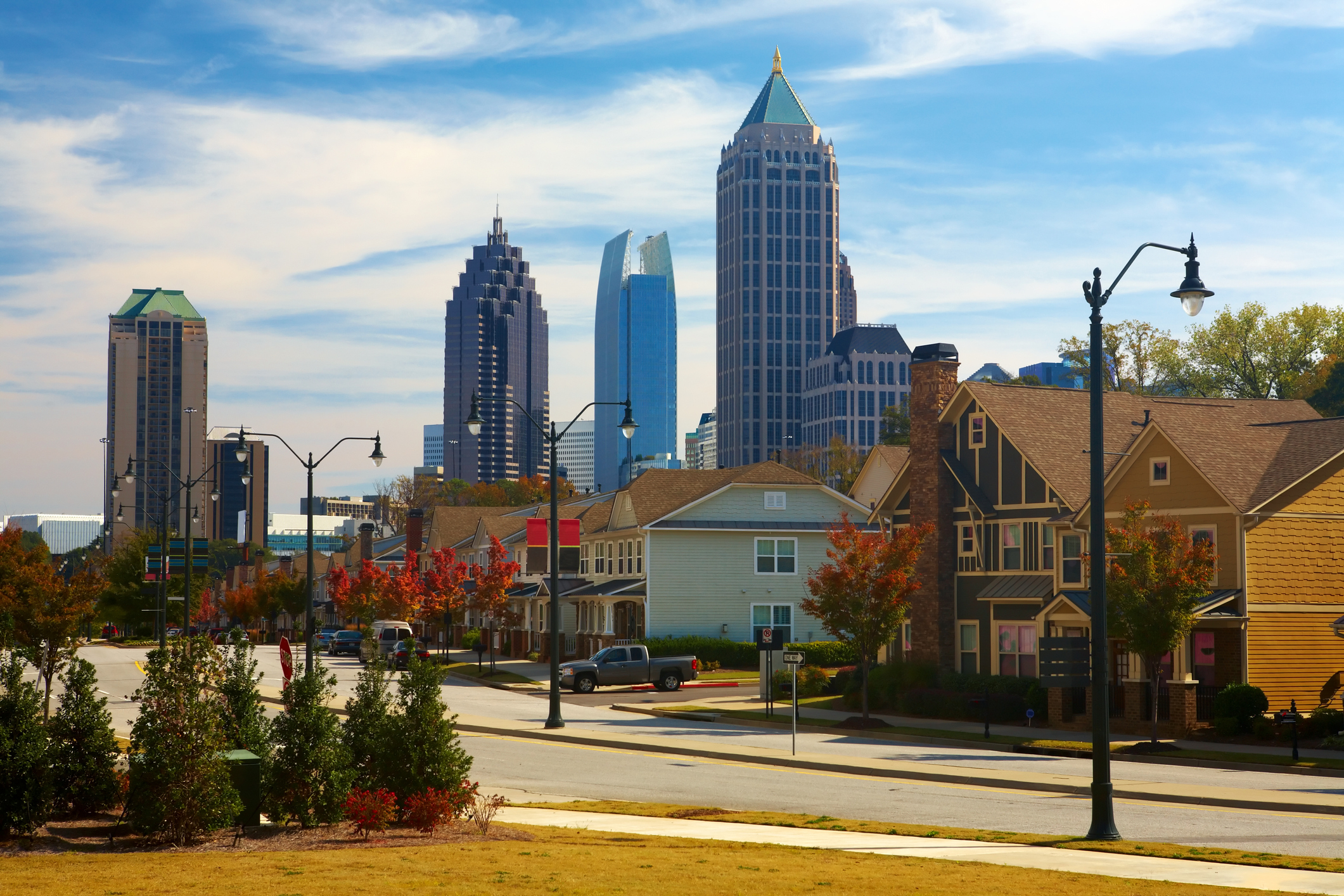 Houses and cars against the midtown. Atlanta, GA. USA.