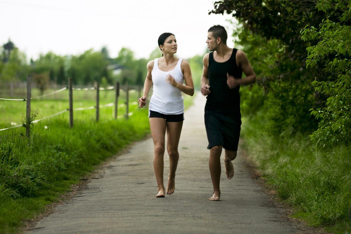 couple running barefoot