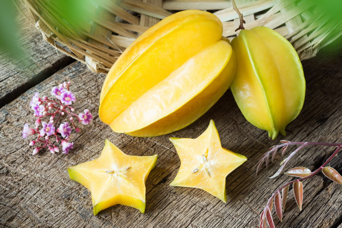 Star fruit next to a basket