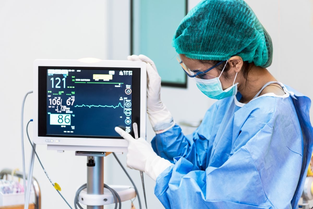 doctor pointing monitor