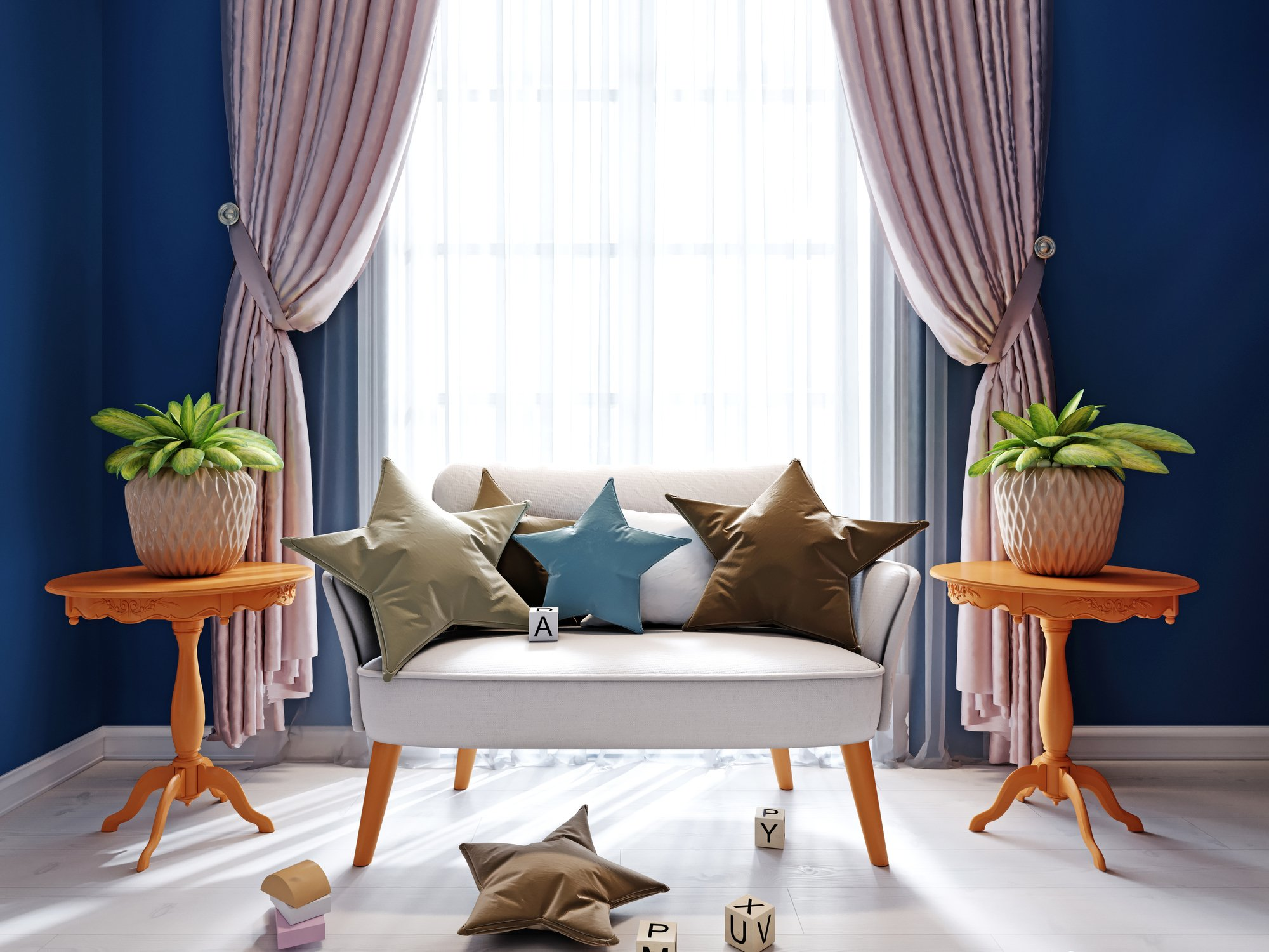Designer sofa with pillows and decor near the window in the children's room. Curtains, tables with a flowerpot.