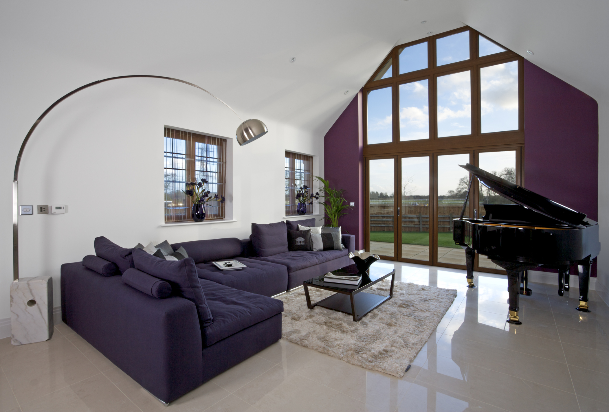 a spectacular lounge in a luxury new home and part of an exclusive development. This room has been decorated and furnished by a leading Interior Designer, with features including a baby grand piano and an extraordinary lamp...
