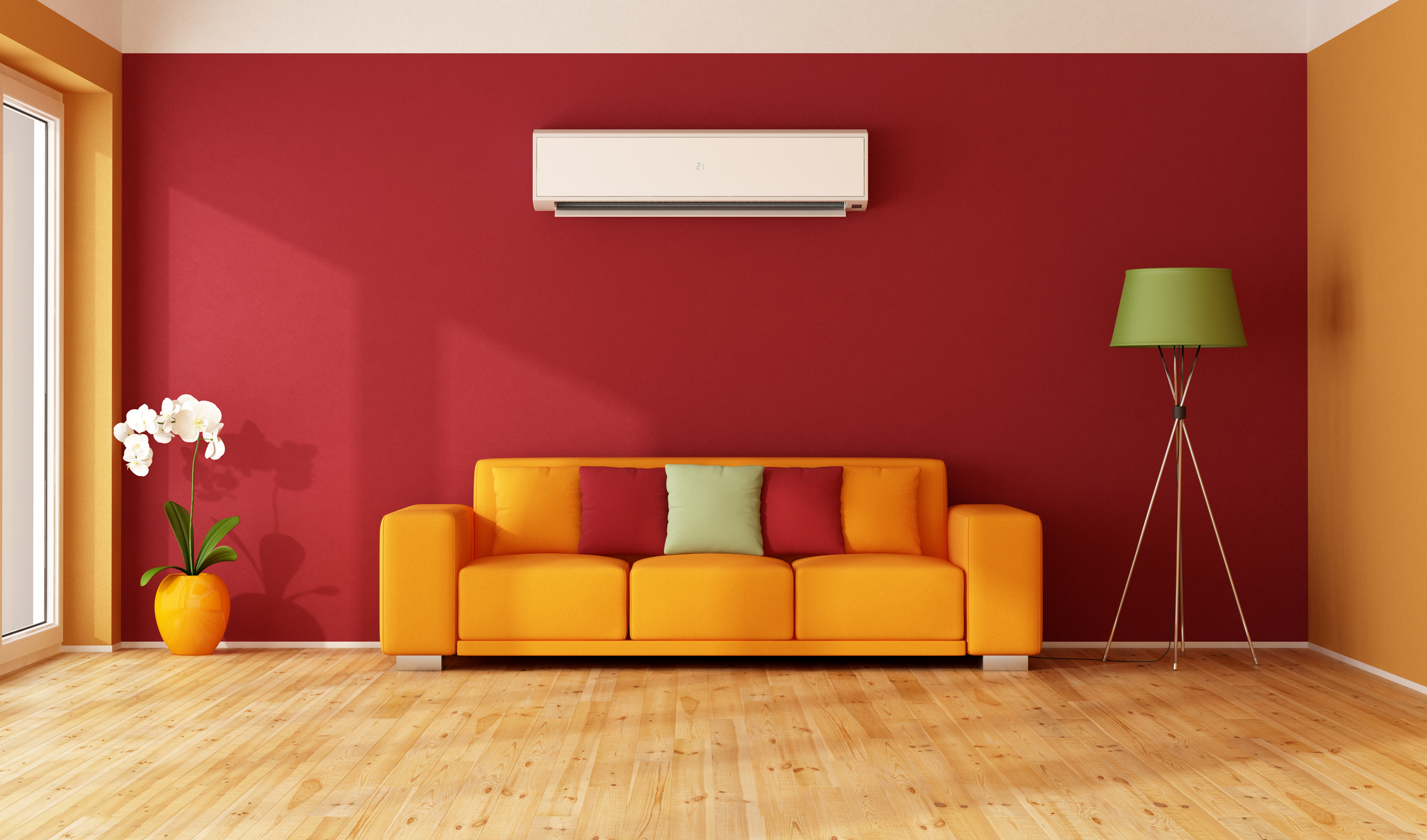 Red and orange living room with colorful sofa and air conditioner