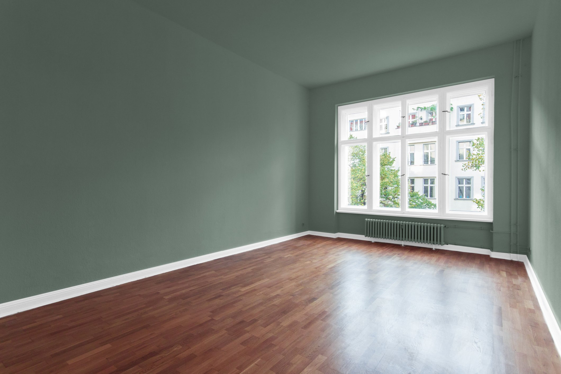 empty room with green, walls and wooden floor