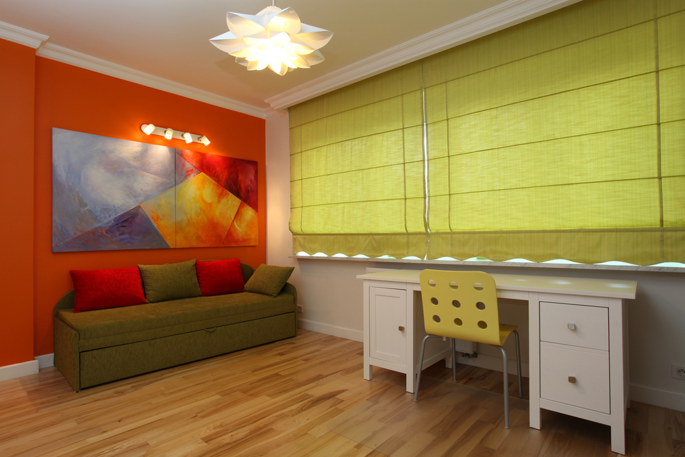 Modern colorful room with orange wall and green blinds