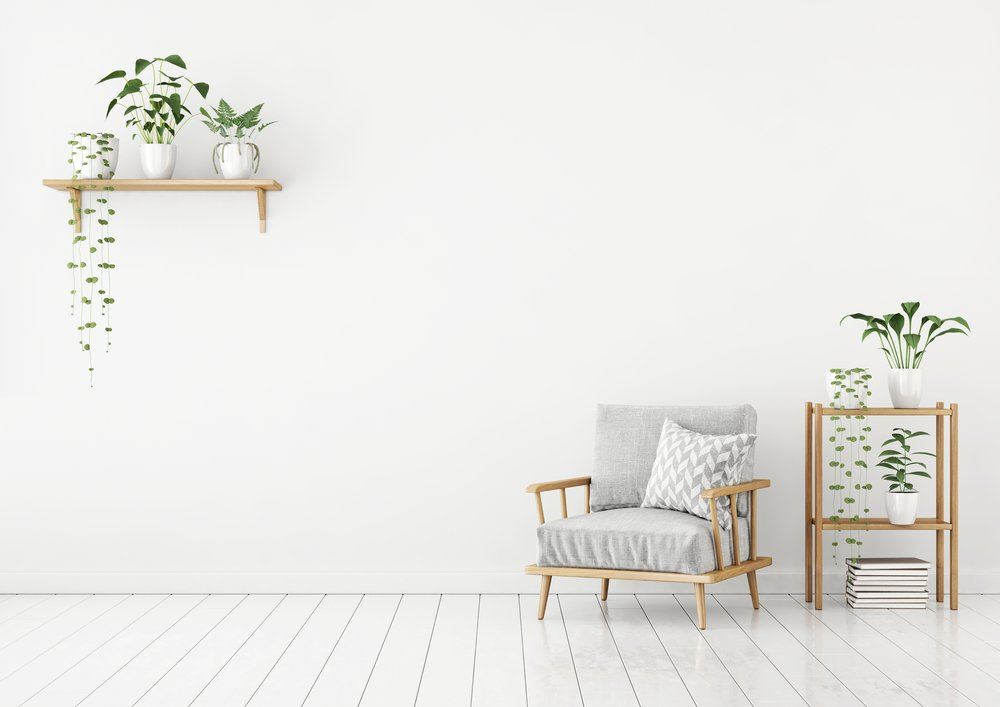White livingroom interior in nordic style with gray armchair, pillow and green plants.