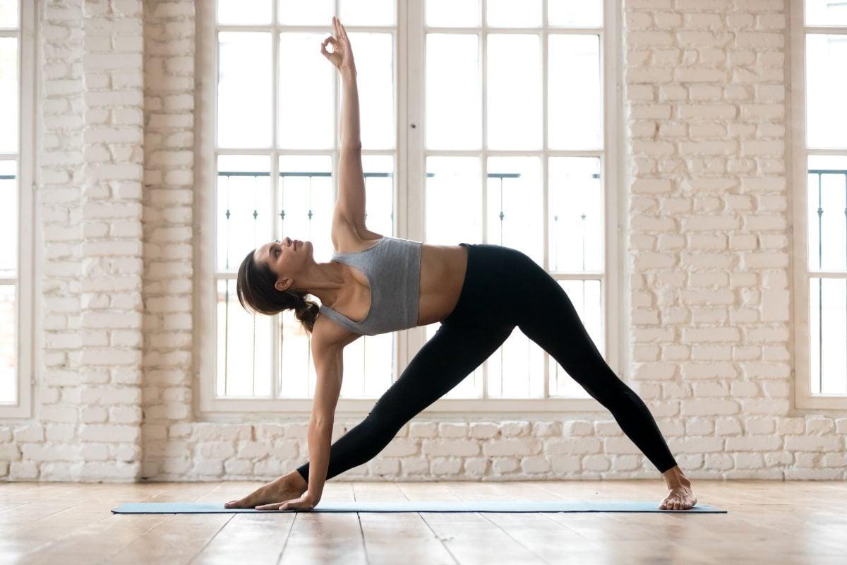 yoga woman triangle pose