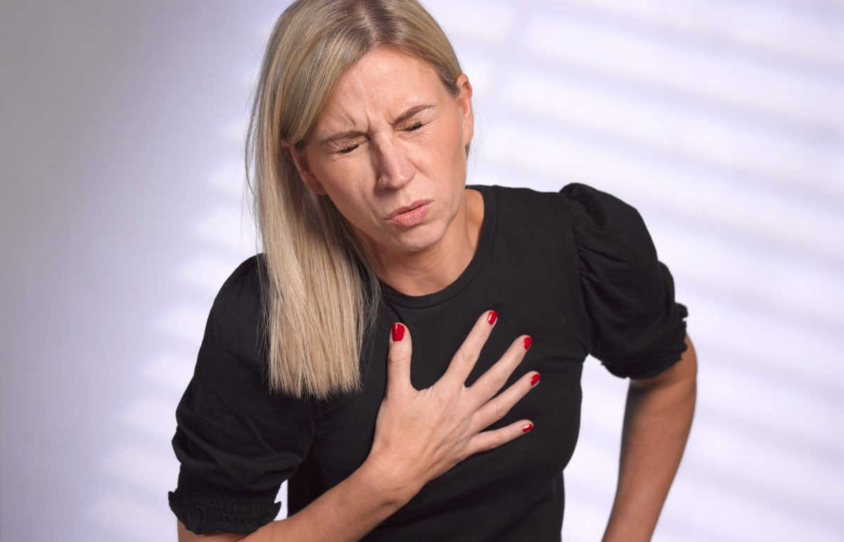 woman with heartburn